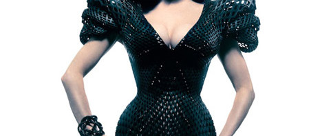 Dita Von Teese models the black plastic netted dress that was manufactured through a 3D printing precess.